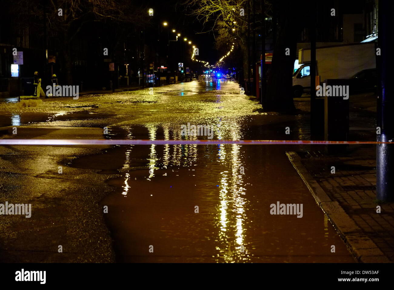 London, UK. 27th Feb, 2014. Burst water main floods the A3 Clapham Rd near Oval station. Pictured: Emergency services Stock Photo