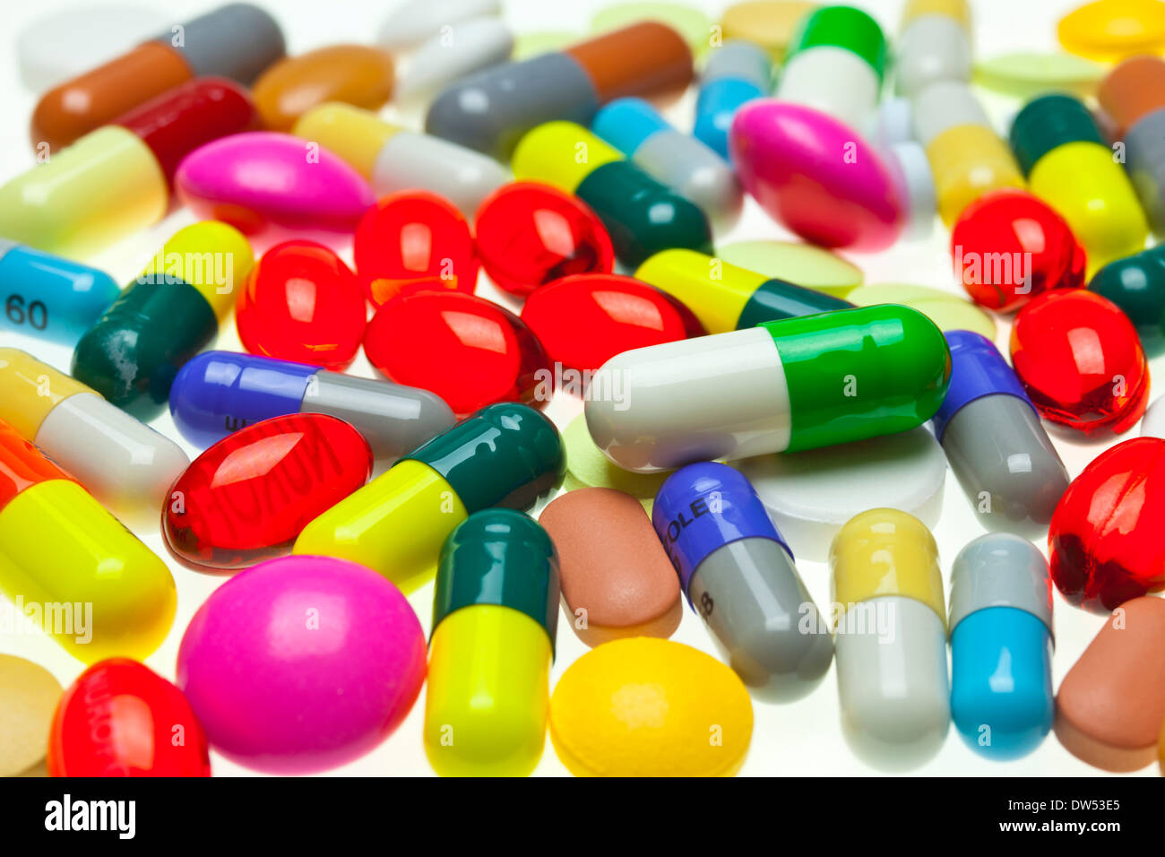 multi-coloured assorted medicines drugs pills and tablets on a white background - Stock Image