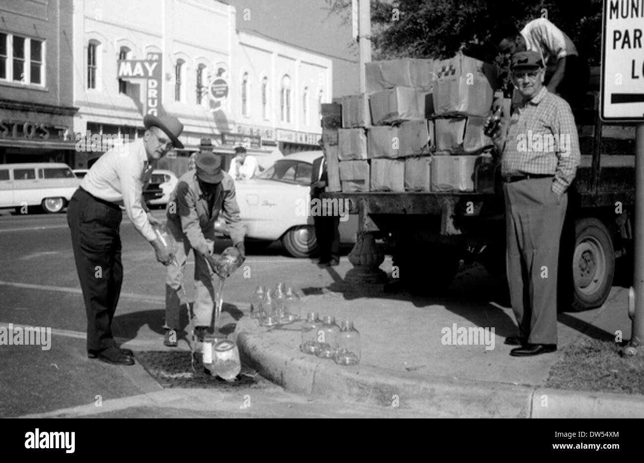 Gadsden County Deputy Sheriff Robert Martin disposing of moonshine in Quincy, Florida - Stock Image