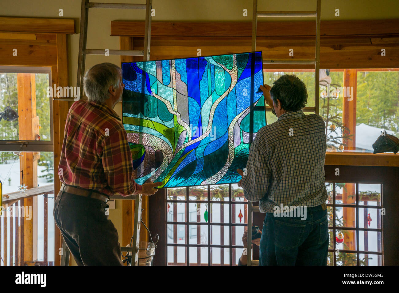 Beautiful stained glass window installation. Designed and crafted by artist Katarzyna Baldys. Stock Photo