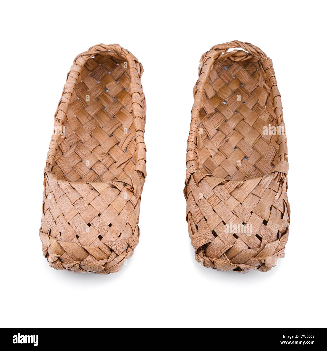 Old Russian bast shoes isolated on white background.Focus on the front. - Stock Image