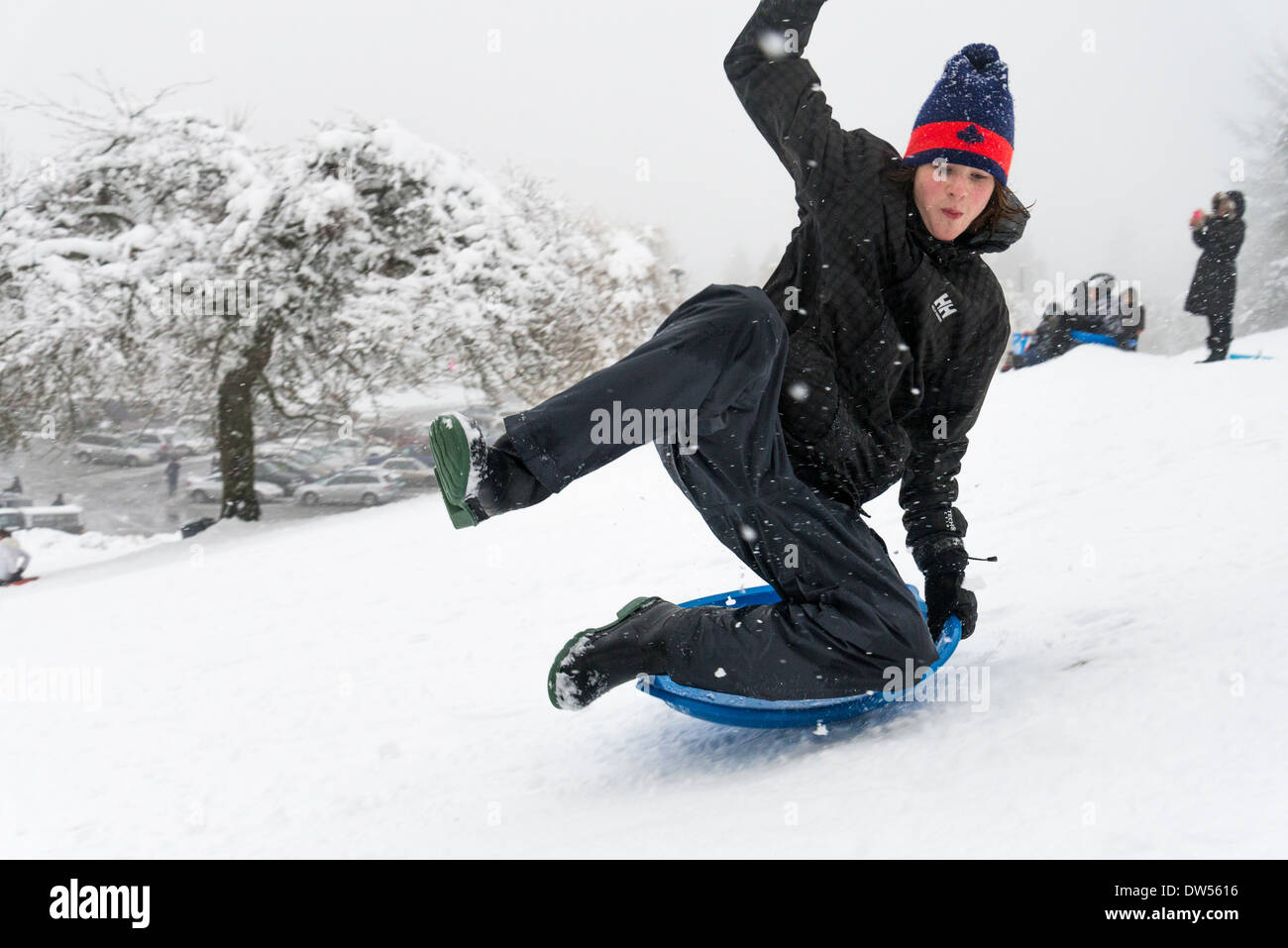 Winter sledding on Burnaby Mountain, British Columbia, Canada - Stock Image
