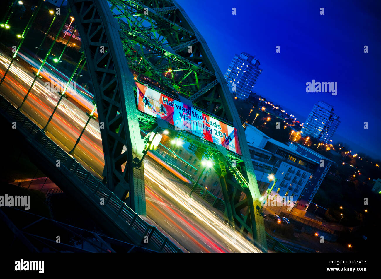 Sunderland, UK. 26th Feb, 2014. Sunderland City Council have put banners on the city's Wearmouth Bridge to celebrate Sunderland AFC reaching the Capital One Cup final. They will play Manchester City at Wembley on Sunday. Credit:  Paul Swinney/Alamy Live News - Stock Image