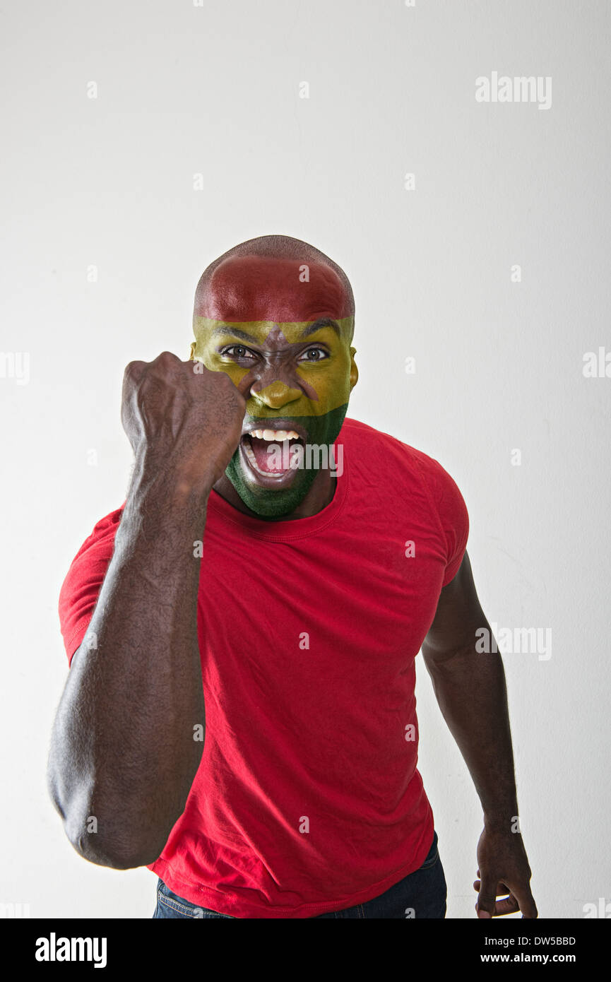 Ghana fan supporting his national team - Stock Image