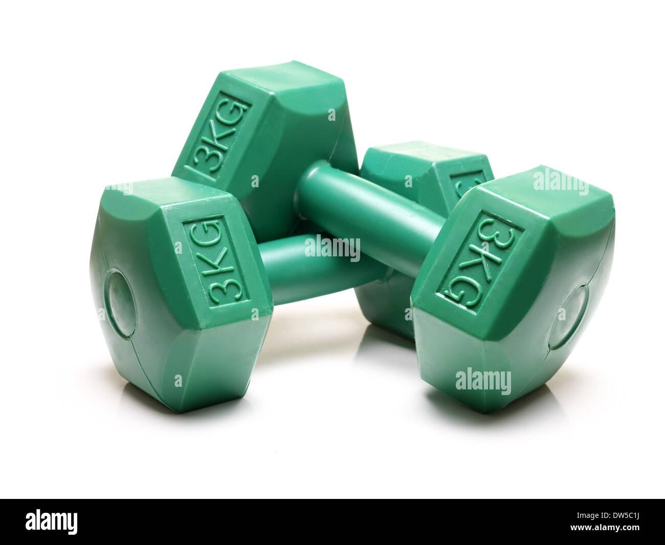 Pair of green 3 kg dumbbells shot over white background - Stock Image