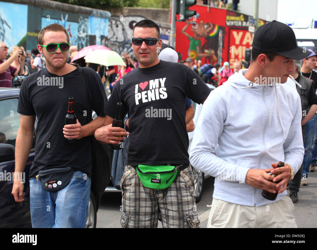 A group of men taking part in protest to protect the East Side Gallery in Berlin, July, 13, 2013. More and more tourists come to the German capital every year. The photo is part of a series on tourism in Berlin. Photo. Wolfram Steinberg dpa - Stock Image