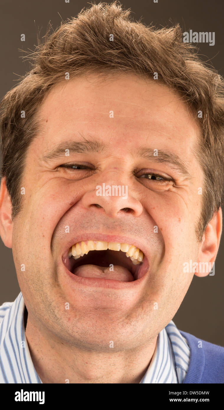 A man laughing loudly - Stock Image