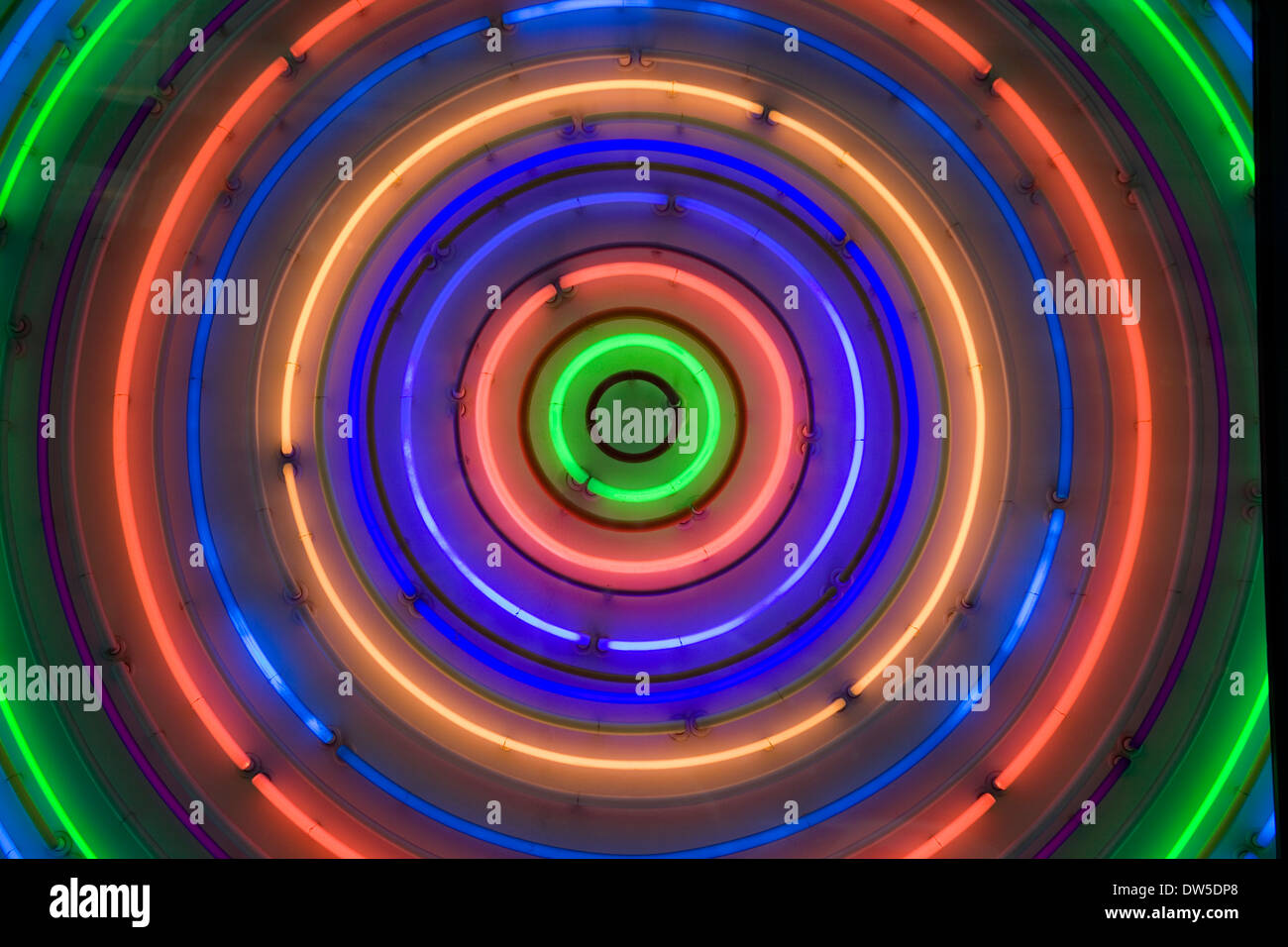Multi colured neon light tubes in concentric circles - Stock Image
