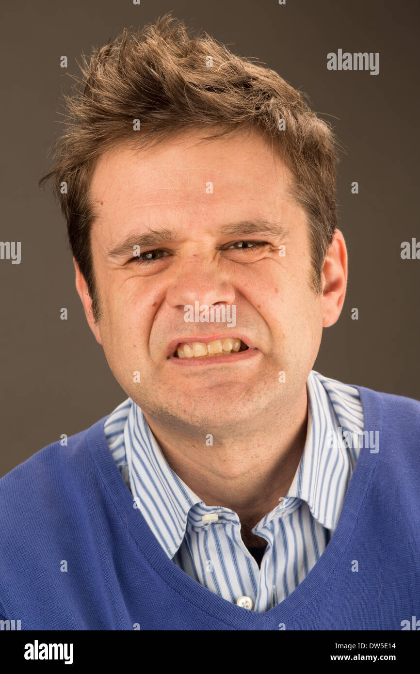 A man looking angry - Stock Image