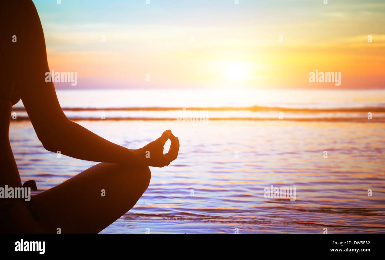 serenity and yoga practicing at sunset, meditation - Stock Image