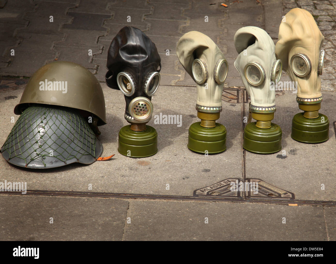 Gas masks and helmets are for sale as souvenirs at Checkpoint Charlie in Berlin, August 09, 2013. More and more tourists come to the German capital every year. The photo is part of a series on tourism in Berlin. Photo. Wolfram Steinberg dpa - Stock Image