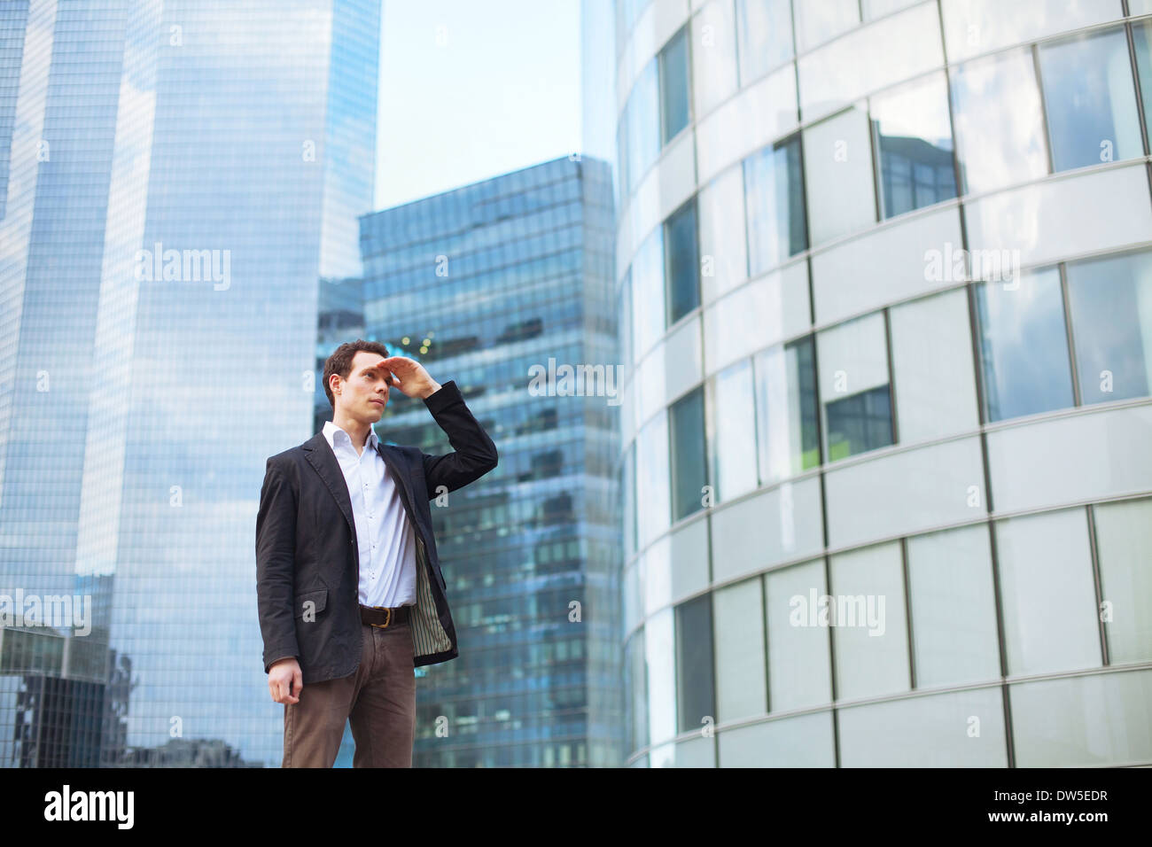 career, young businessman looking forward - Stock Image