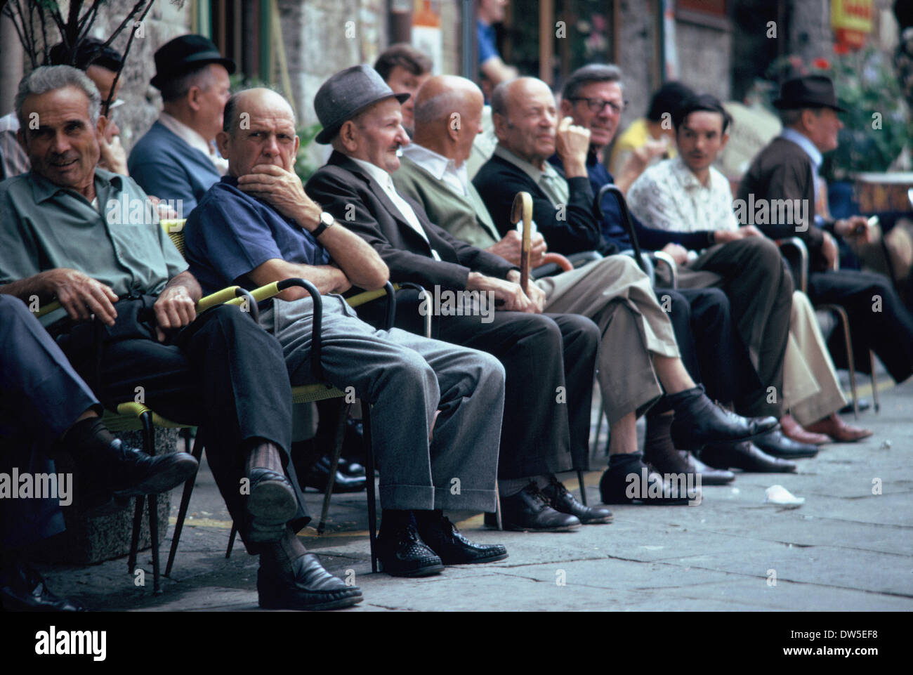 Italian men sitting in a square in Florence in the evening sun, 1969 - Stock Image