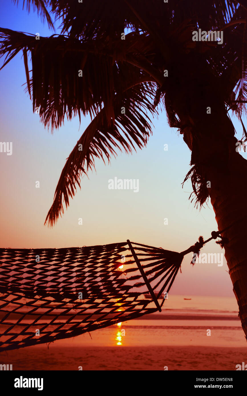 hammock on the beach by sunset - Stock Image