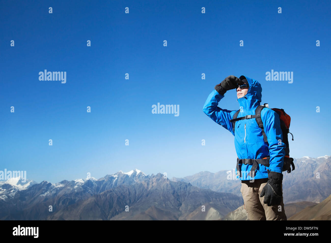 backpacker in the mountains - Stock Image