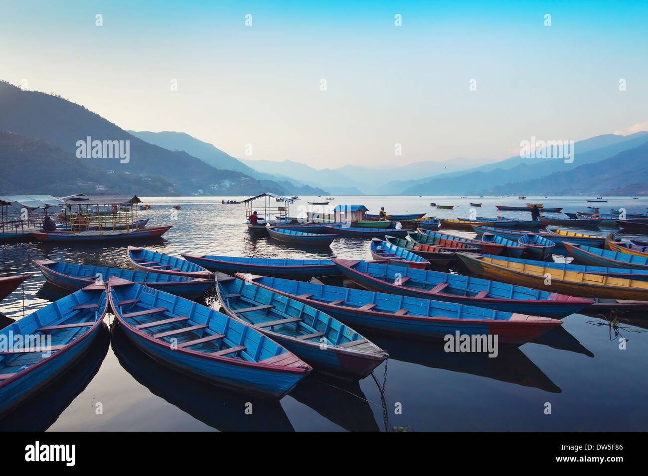 beautiful view of wooden boats in Phewa lake, Pokhara, Nepal - Stock Image