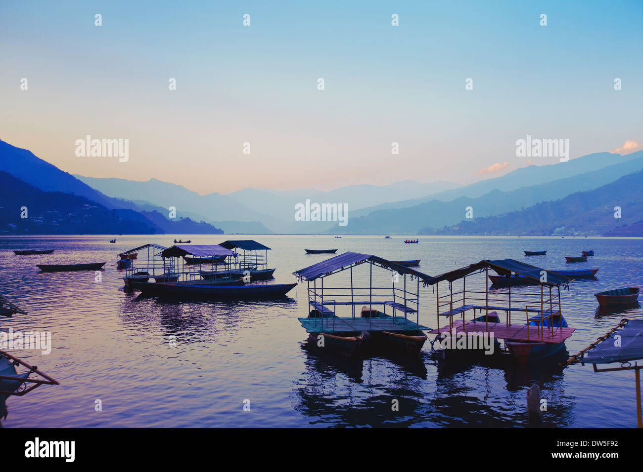 beautiful awesome sunset over Phewa lake, Pokhara, Nepal - Stock Image