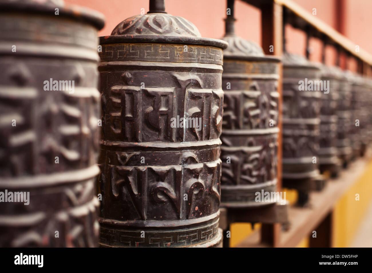 prayer mills in buddhist monastery - Stock Image