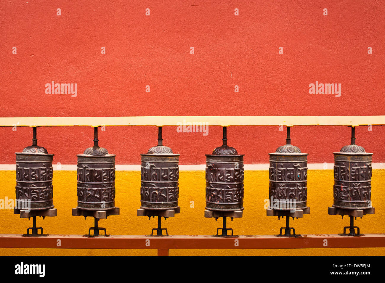 background about buddhism, prayer mills in buddhist monastery - Stock Image