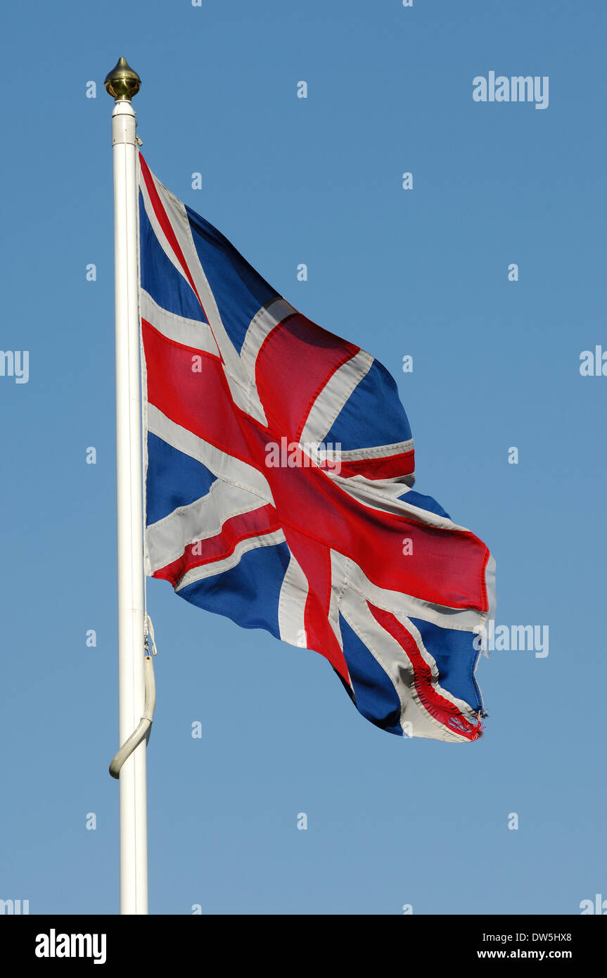 British Union Jack Flag fluttering in the wind - Stock Image