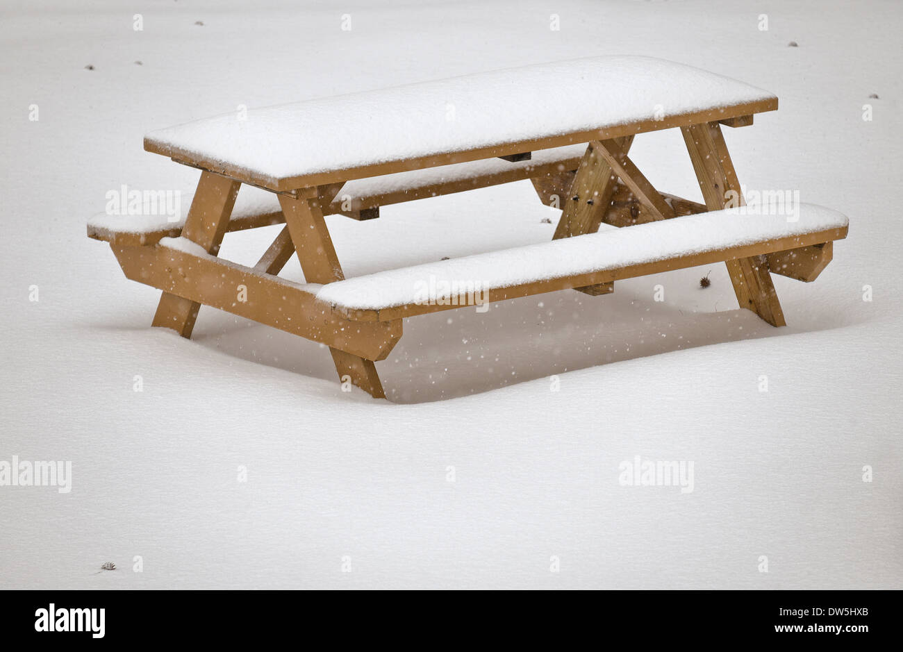 Snow covered picnic table - Stock Image