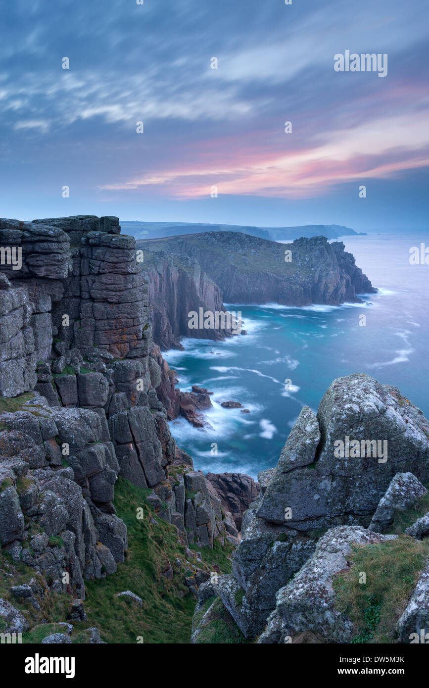 Towering cliffs at Land's End in Cornwall at dawn, England. - Stock Image
