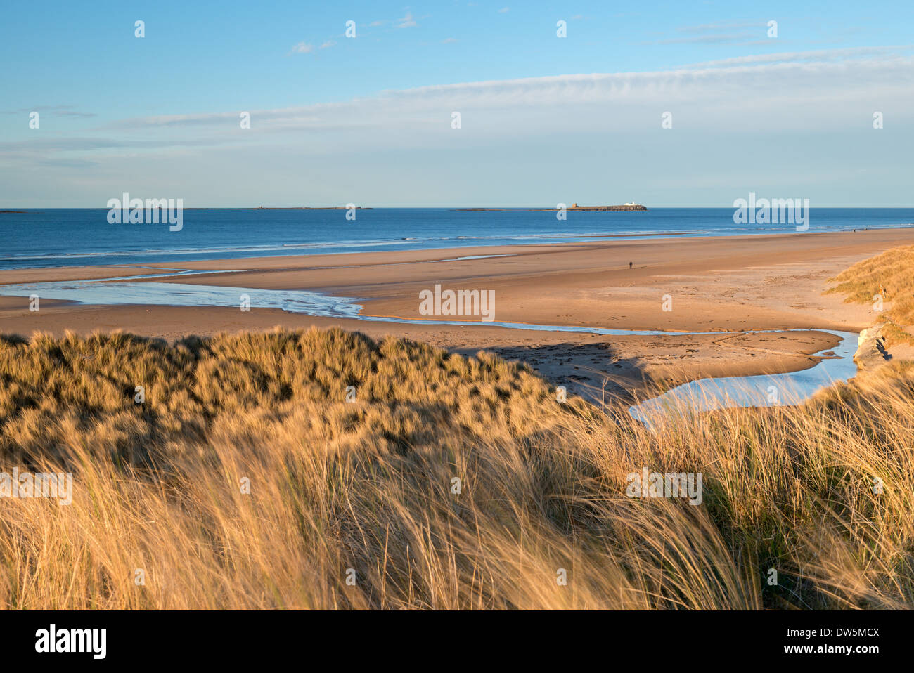 View across the beautiful Bamburgh Beach towards the Farne Islands, Northumberland, England. Spring (April) 2013. - Stock Image