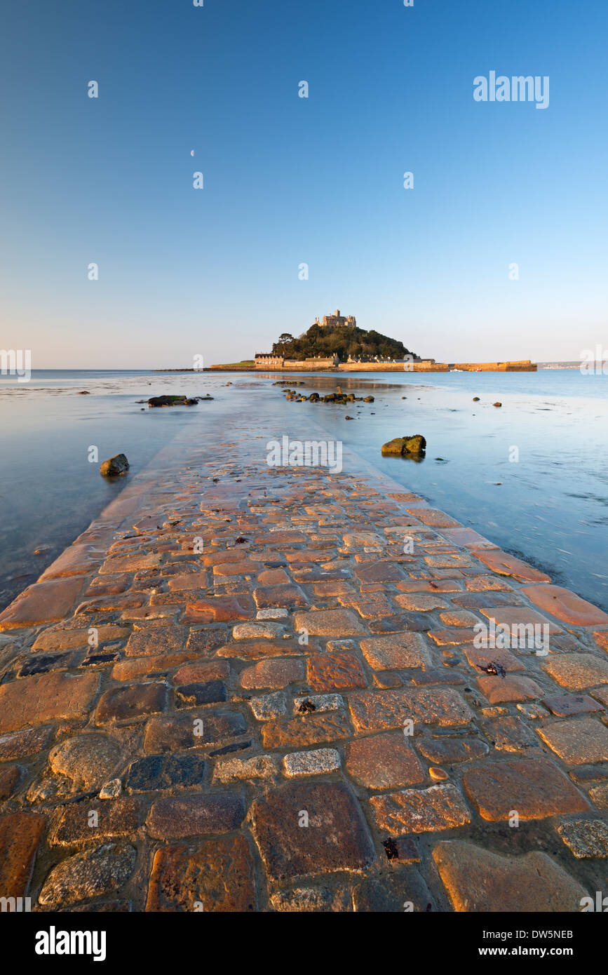 St Michaels Mount and the Causeway in early morning sunlight, Marazion, Cornwall, England. Spring (May) 2013. - Stock Image