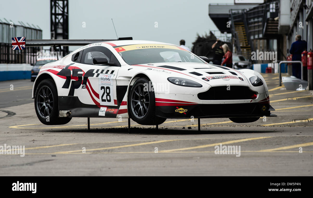 Horsepower Racing And Aston Martin Racing V12 Vantage GT3 Car Standing In  The Pits, At Donington Park Circuit.