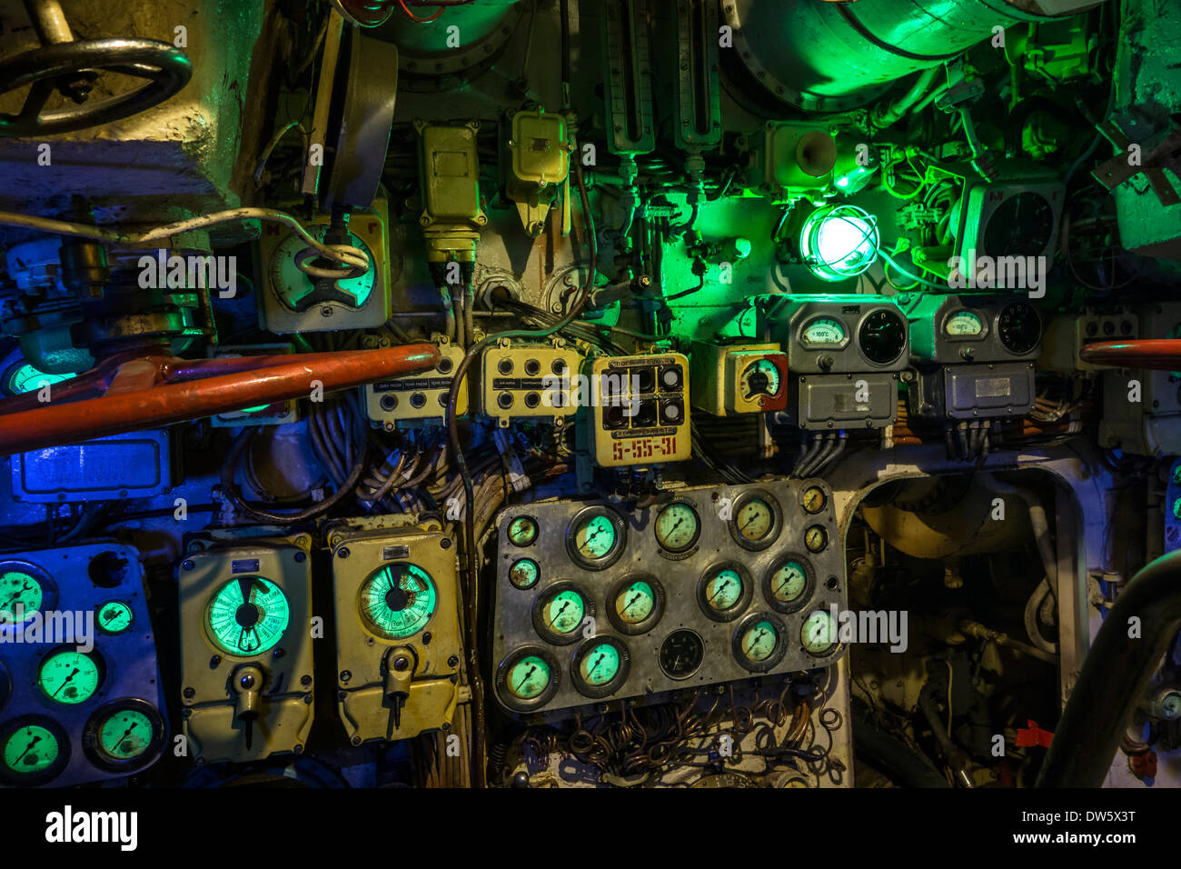 Green indicators and dials on instruments in operations / control room inside Russian submarine B-143 / U-480 Foxtrot, Zeebrugge - Stock Image