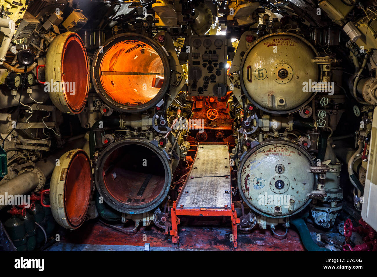 Opened torpedo tubes in aft torpedo room inside Russian diesel-electric submarine B-143 / U-480 Foxtrot type 641 Stock Photo