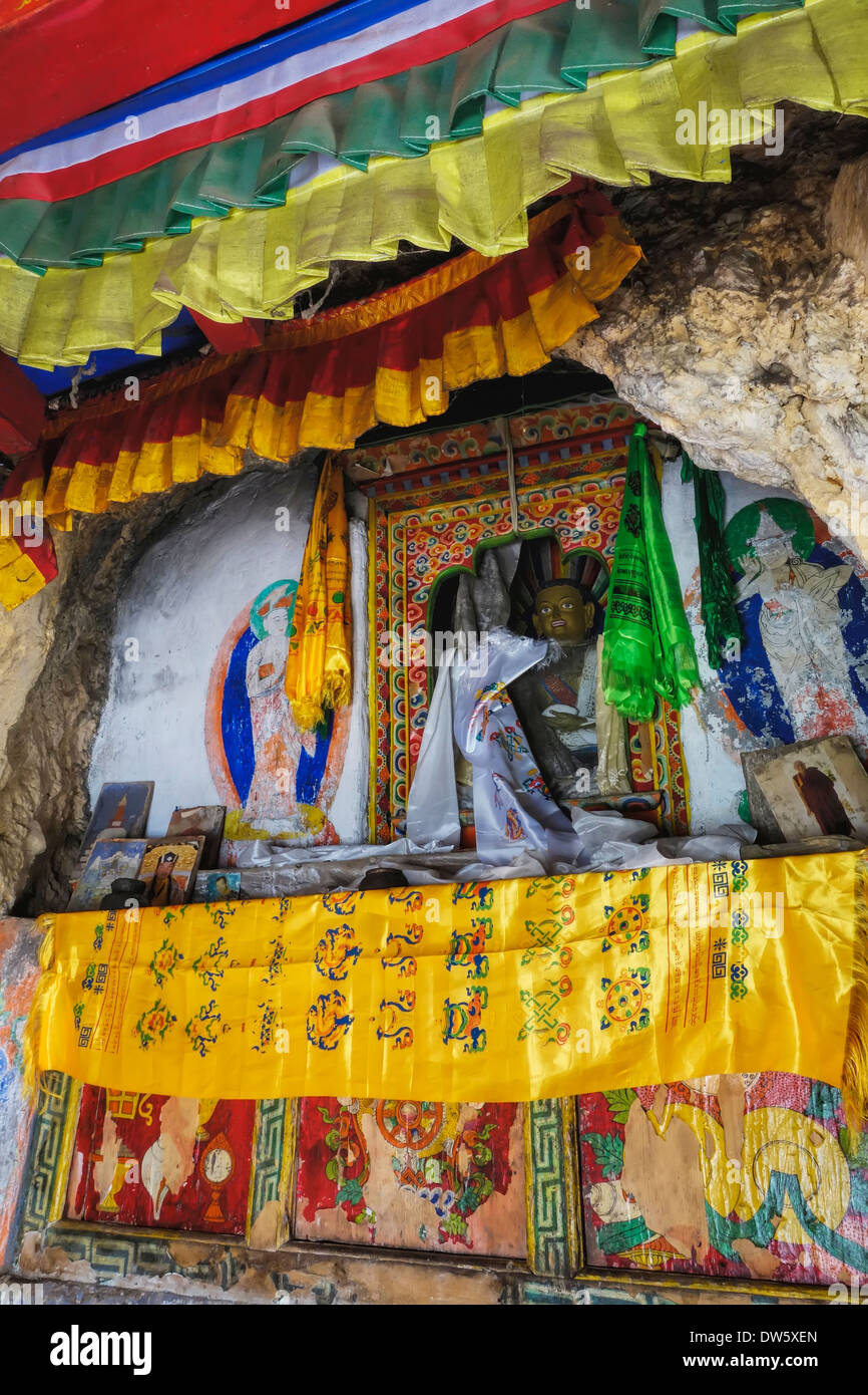 Religious artifacts in the Milarepa Cave shrine, Tsum Valley, Nepal. - Stock Image