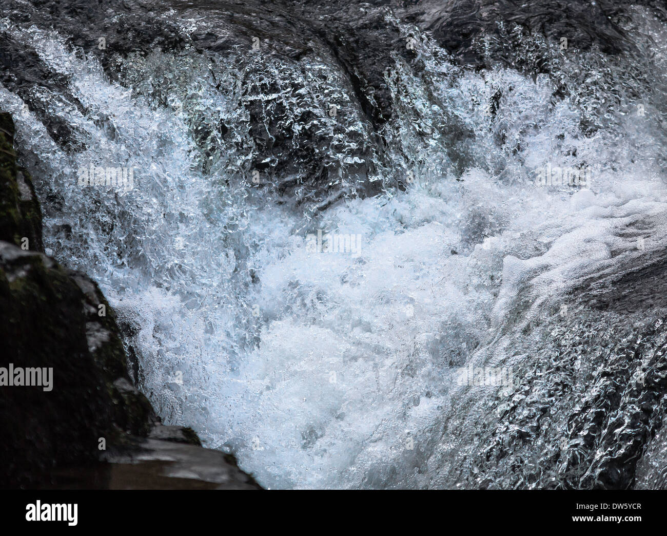 Waterfall froth and foam frozen in action - Stock Image