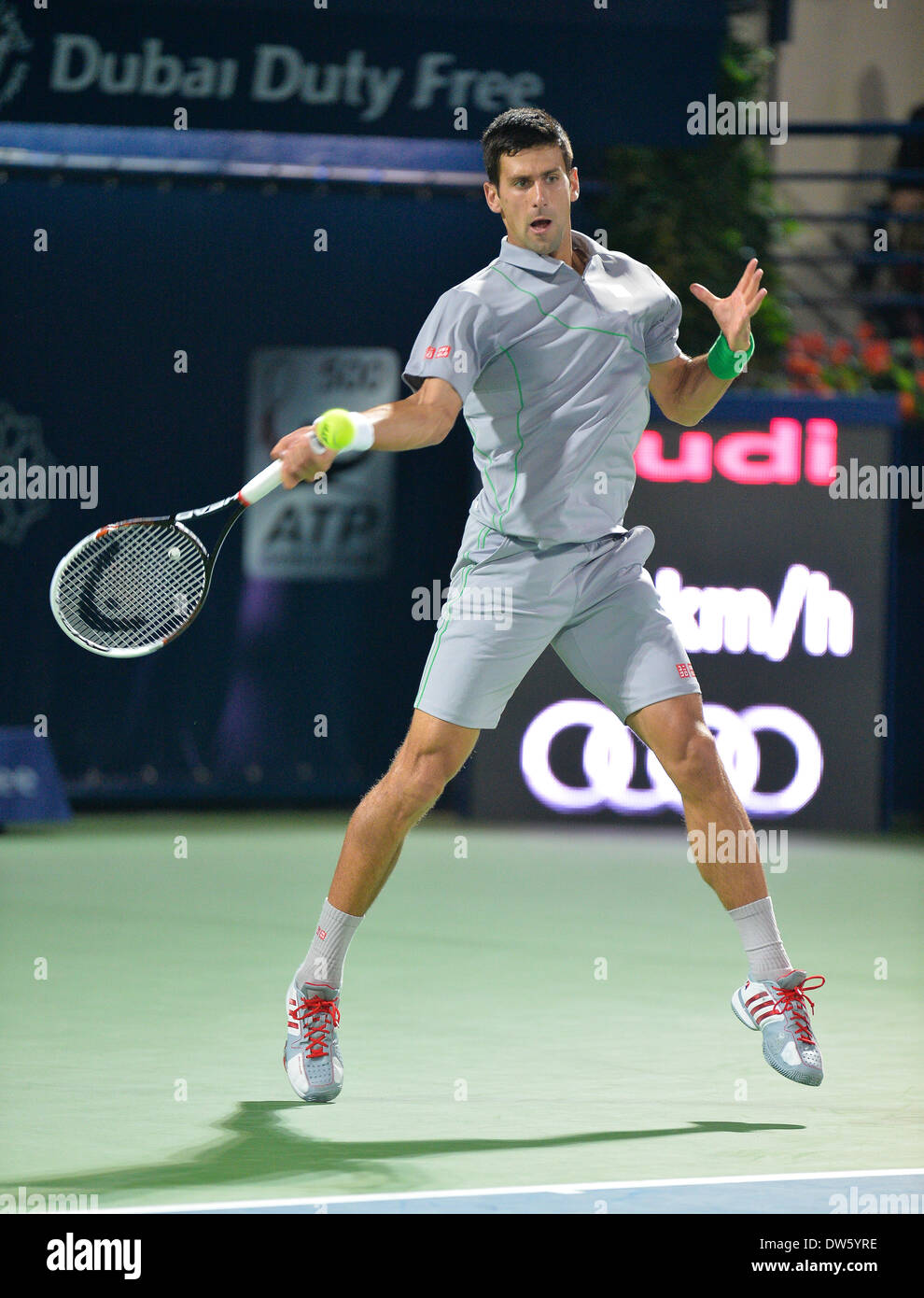 DUBAI, UAE, 27th Feb 2014. Novak Djokovic plays a forehand against Roger Federer  in the quarterfinals of the Dubai Duty Free Tennis Championships. Federer won 3-6 6-3 6-2 to advance to the finals of the tournament Credit:  Feroz Khan/Alamy Live News - Stock Image
