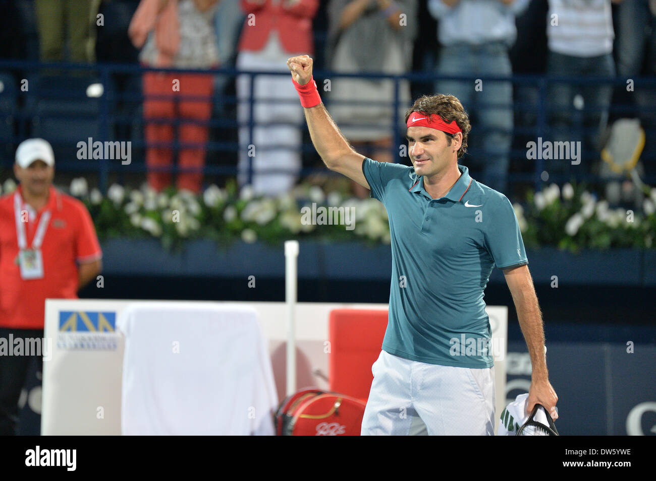 DUBAI, UAE, 27th Feb 2014. Roger Federer celebrates his victory against Novak Djokovic in the quarterfinals of the Dubai Duty Free Tennis Championships. Federer advanced to the finals of the tournament with a 3-6 6-3 6-2 victory Credit:  Feroz Khan/Alamy Live News - Stock Image