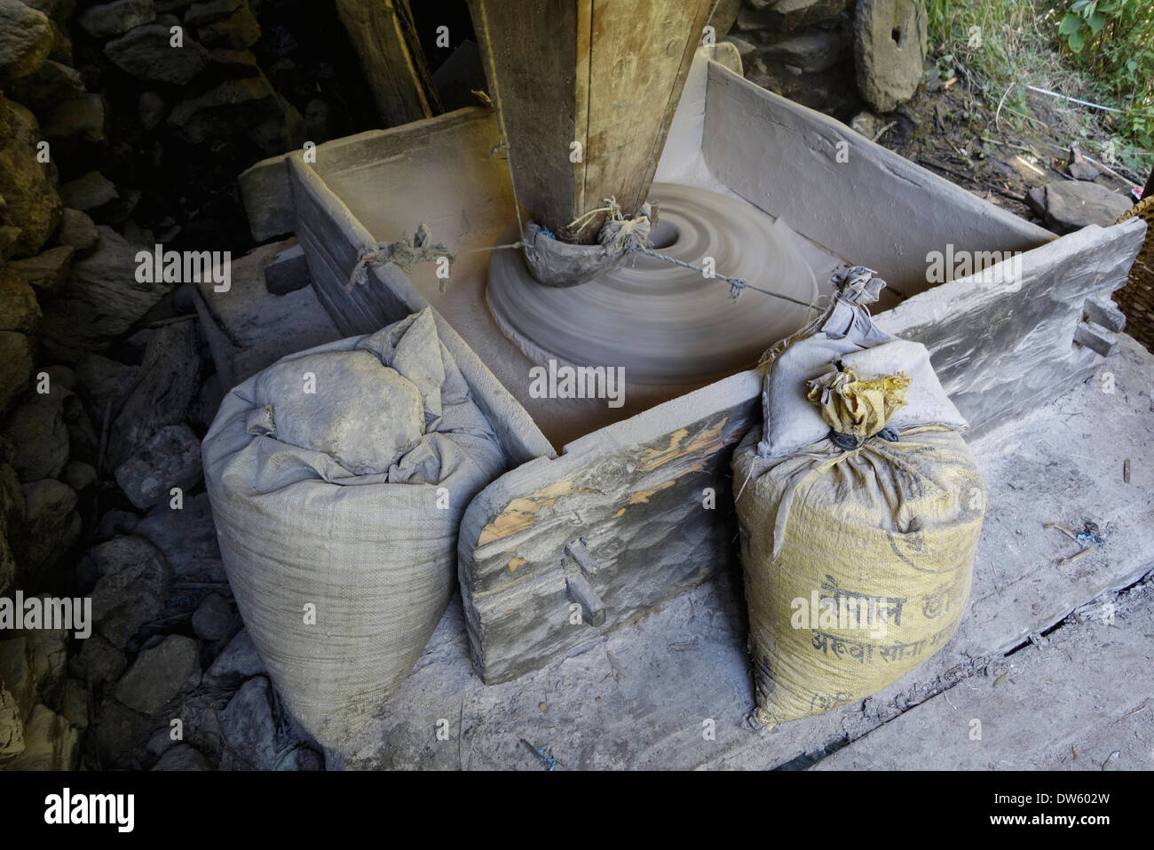 Water powered grinding mill in the Gorkha region of Nepal. - Stock Image