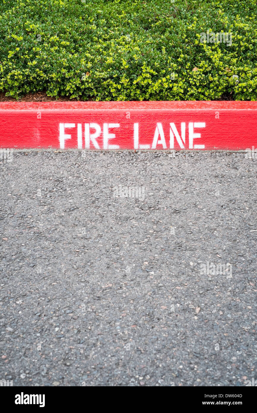 Curb with Fire Lane painted on - Stock Image