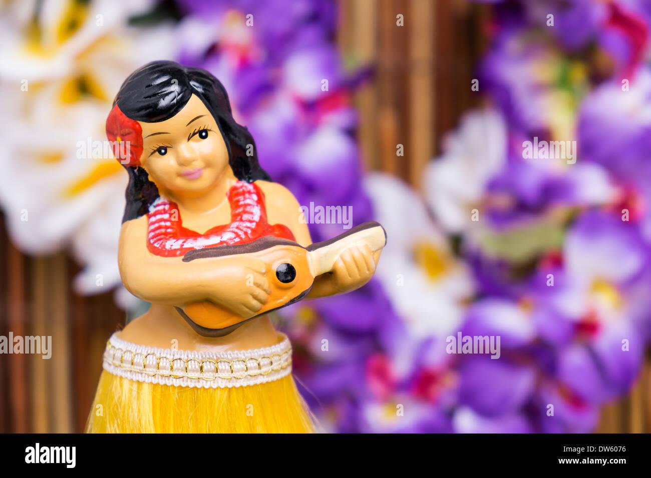 Tropical setting for a Hula girl doll - Stock Image