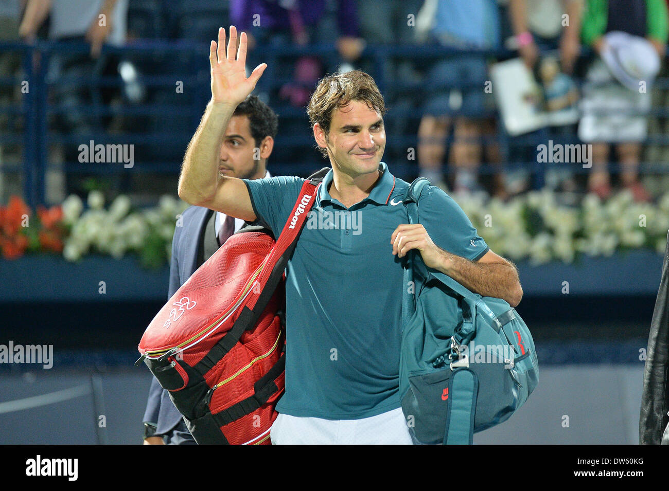 DUBAI, UAE, 27th Feb 2014. Roger Federer waves to the crowd after a his victory against Novak Djokovic in the quarterfinals of the Dubai Duty Free Tennis Championships. Federer advanced to the finals of the tournament with a 3-6 6-3 6-2 victory Credit:  Feroz Khan/Alamy Live News - Stock Image