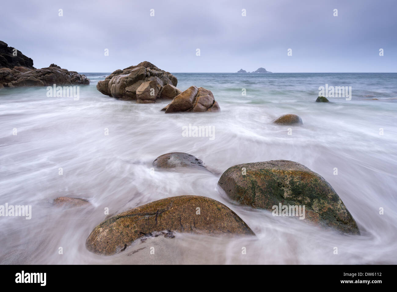 Waves wash over the beach at Porth Nanven near Land's End, Cornwall, England. Autumn (October) 2013. - Stock Image