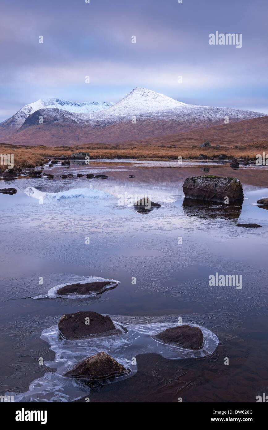 Frozen lochan reflecting the Black Mount, Rannoch Moor, Scotland. Winter (November) 2013. - Stock Image