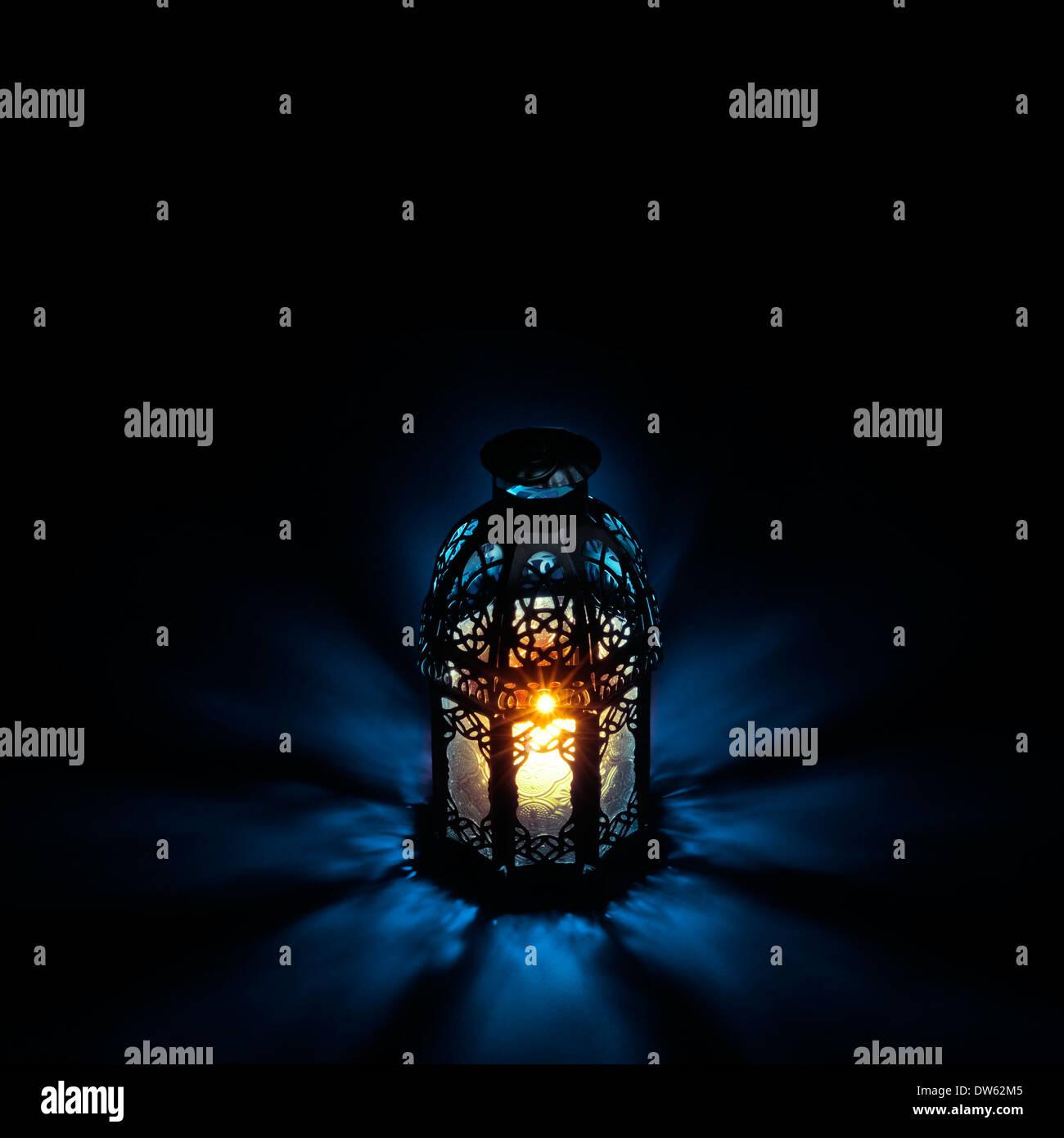An illuminated Arabic lantern on back background - Stock Image