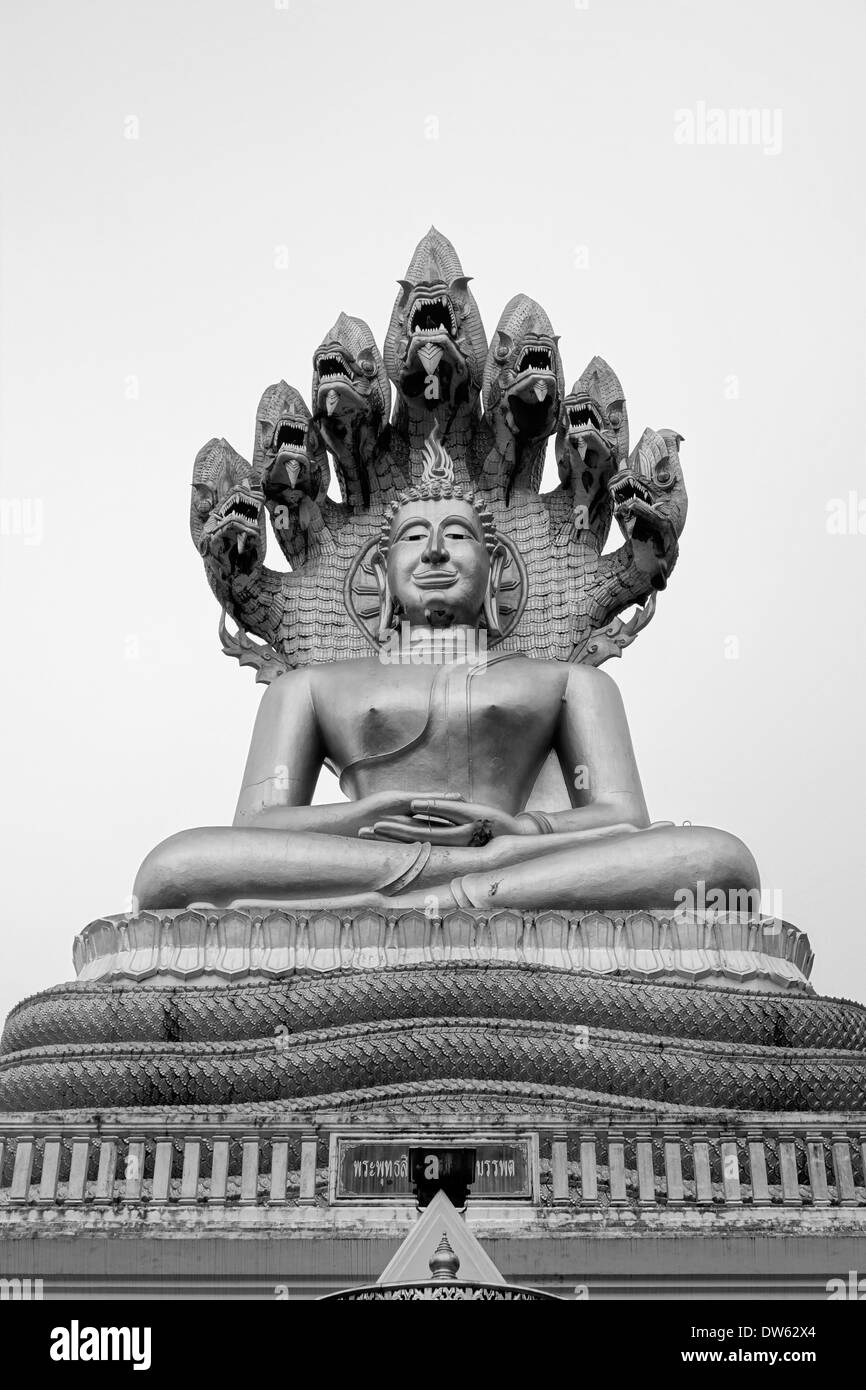Phra Nakprok meditation center with Buddha with seven-headed serpent statue on the roof, Nakrpok Temple complex, Thailand. - Stock Image