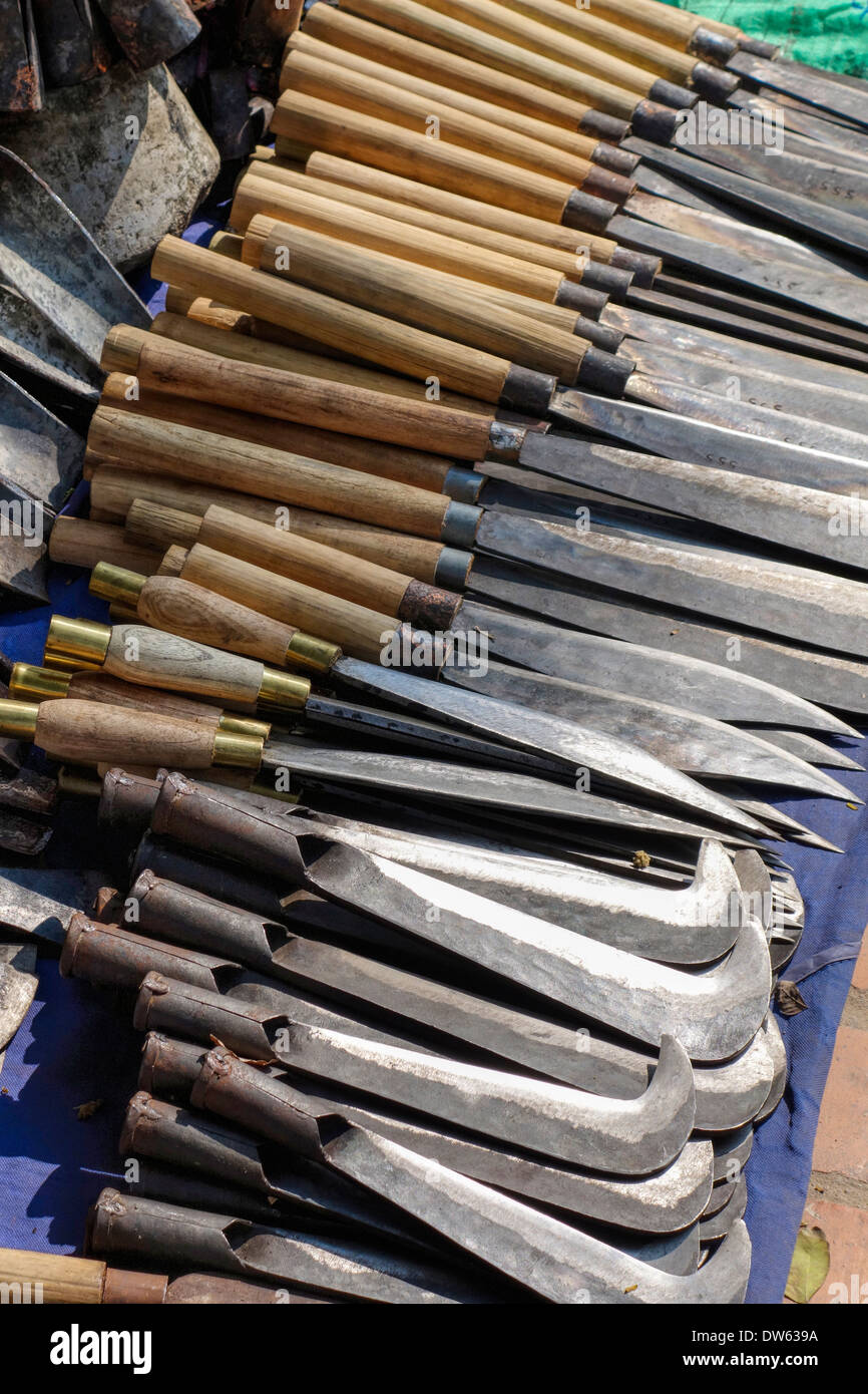 Knives for sale by a street vendor in Luang Prabang, Laos. - Stock Image