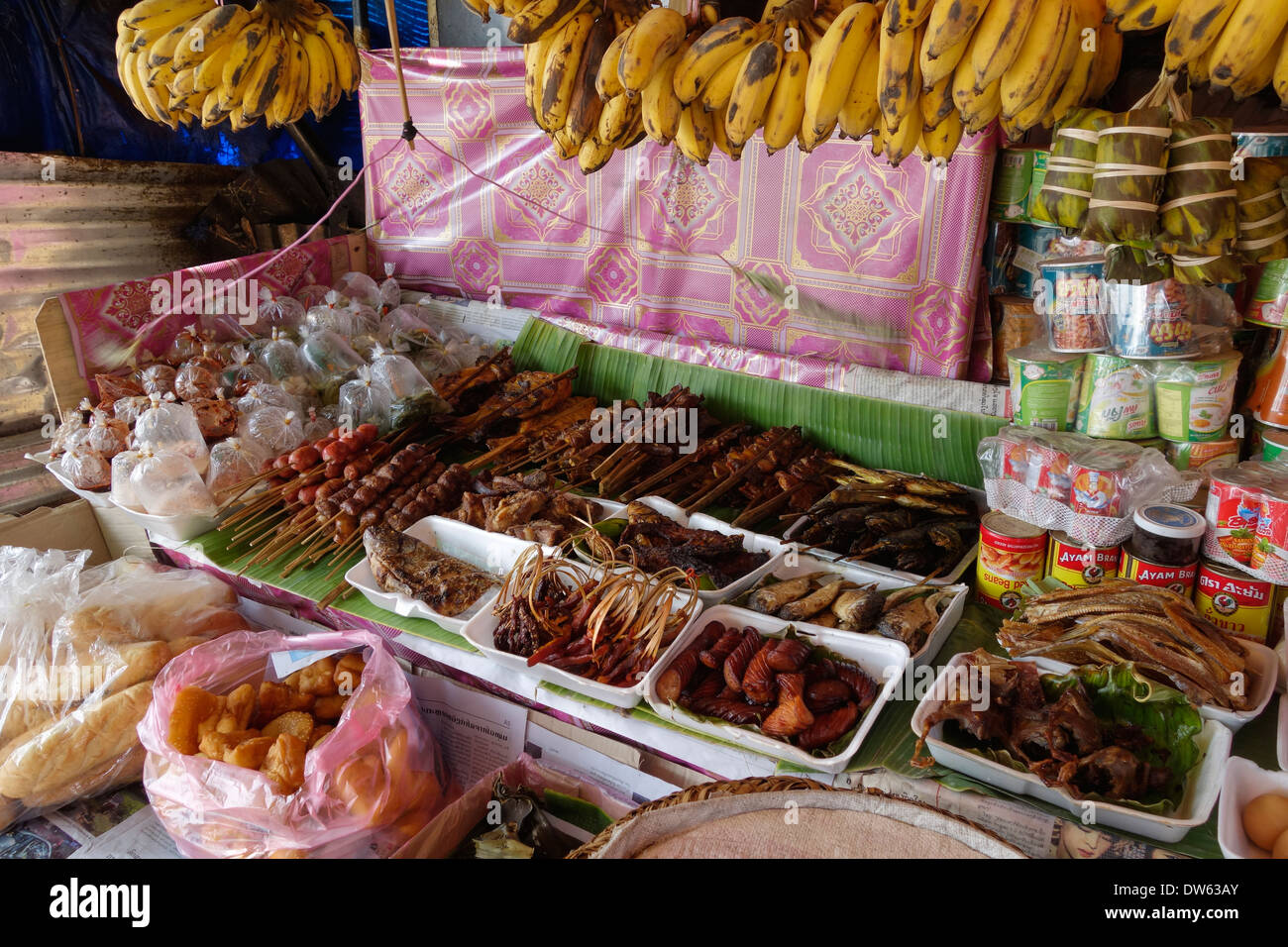 Food for sale in front of a shop in Vientiane, Laos. - Stock Image
