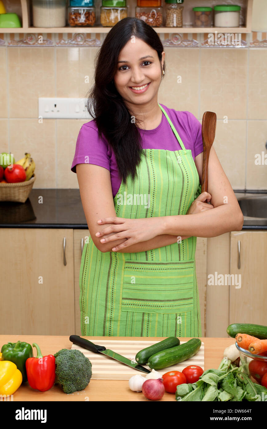 Smiling Young Indian Woman In Her Kitchen Stock Photo 67134056