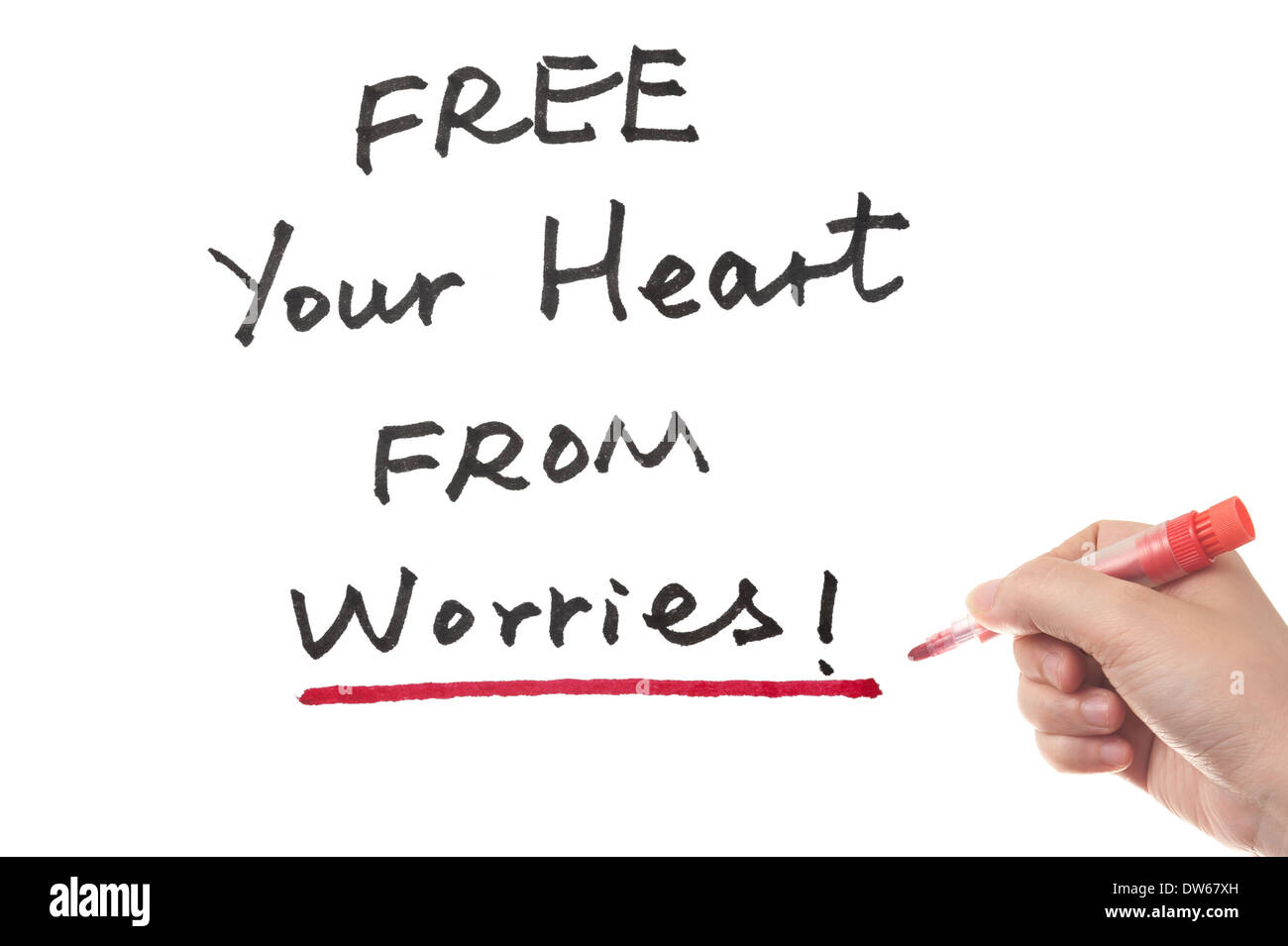 Free your heart from worries words written on white board - Stock Image