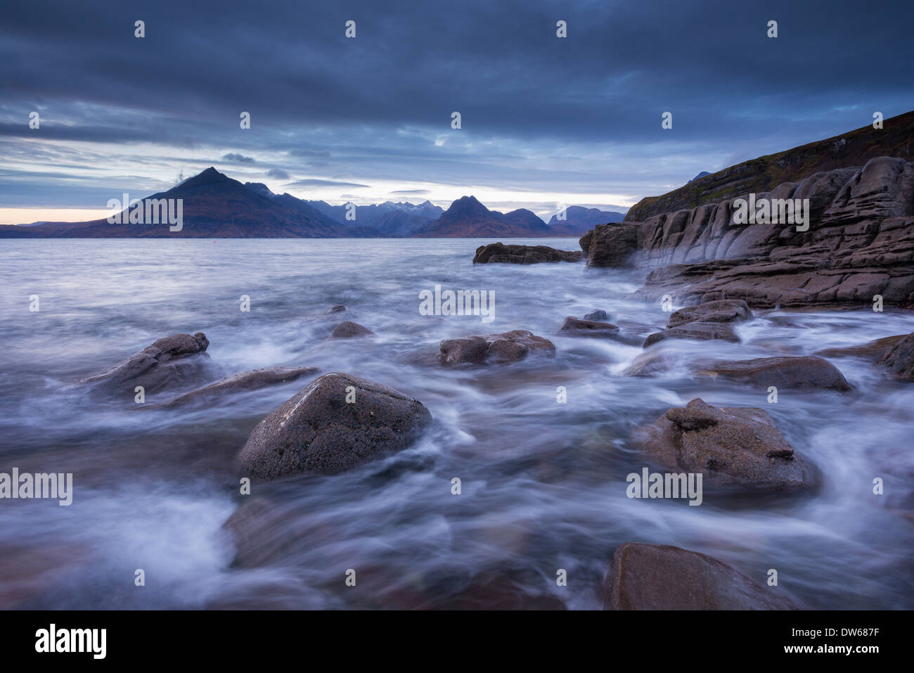 Waves rush around the rocky shores of Elgol, Isle of Skye, Scotland. Winter (December) 2013. - Stock Image