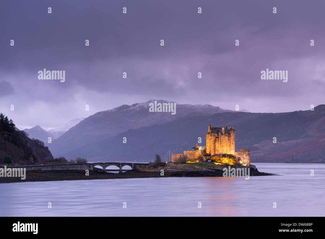 Twilight over Eilean Donan Castle on Loch Duich, Dornie, Scotland. Winter (December) 2013. - Stock Image