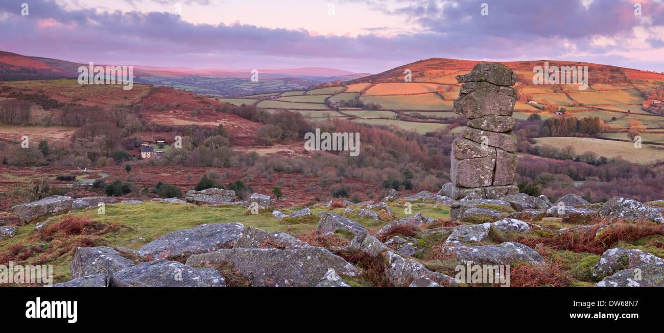Dawn over Bowerman's Nose on Dartmoor, Devon, England. Winter (January) 2014. - Stock Image